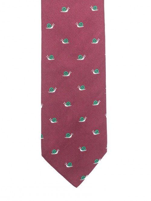 Las corbatas SOLOiO son confeccionadas en los telares del Lago di Como,al norte de Italia, en seda italiana de primera calidad, Su elaboración completamente artesanal, le confiere una elegante caída. Además,gracias a la exquisita técnica empleada en la elaboración de su interior, las corbatas SOLOiO mantienen el nudo siempre perfecto. Un diseño desenfadado,con caracoles bordados color verde,sobre fondo burdeos. www.soloio.com #soloio #soloiomioda #shoponline #tie #corbata #menstyle #bespocke…