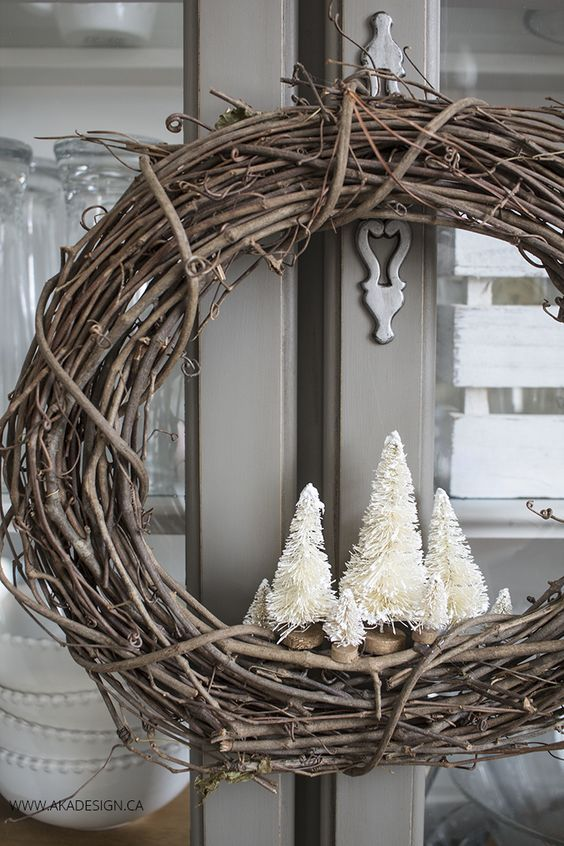 Make your own VERY simple rustic winter wreath with a grapevine wreath and a few bottle brush trees!: