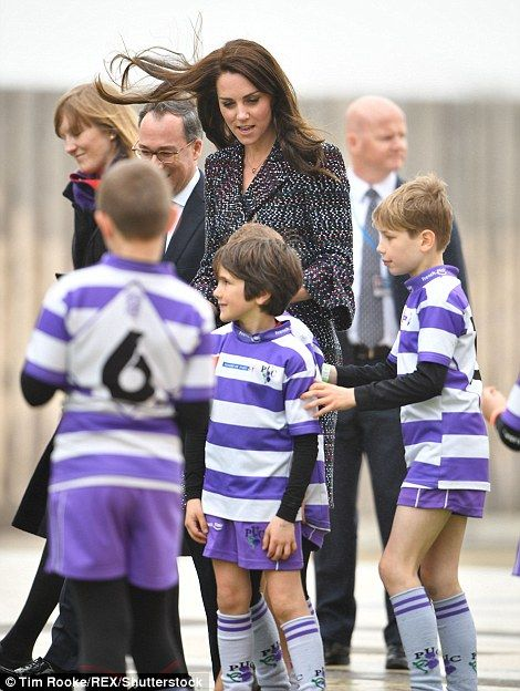 Kate played with youngsters were full of energy as they bounded around the pitch set up outside the Eiffel Tower