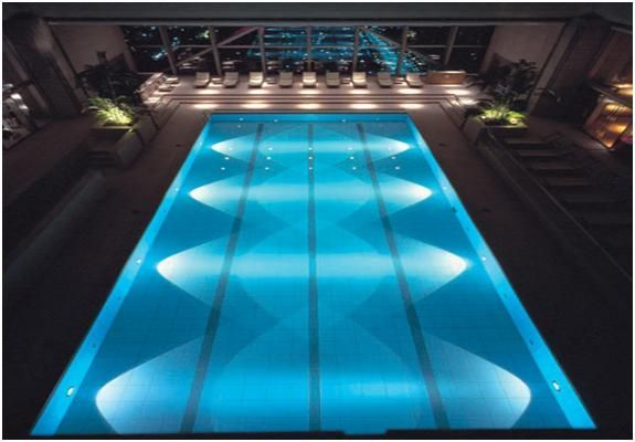 located on the floor the swimming pool is glass enclosed foyer with views of the city - Olympic Swimming Pool Top View