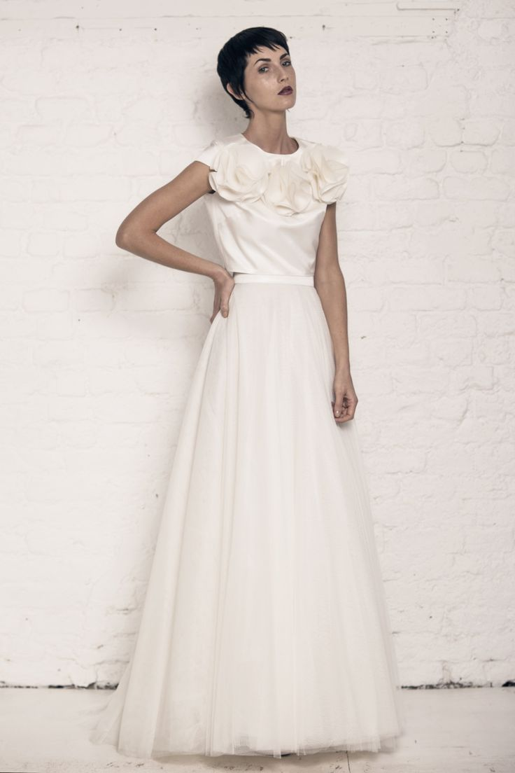 Modern wedding dress for the contemporary bride. Vesta top, Felicity Skirt. Silk duchess top with tulle and organza flowers. Tulle ball skirt.