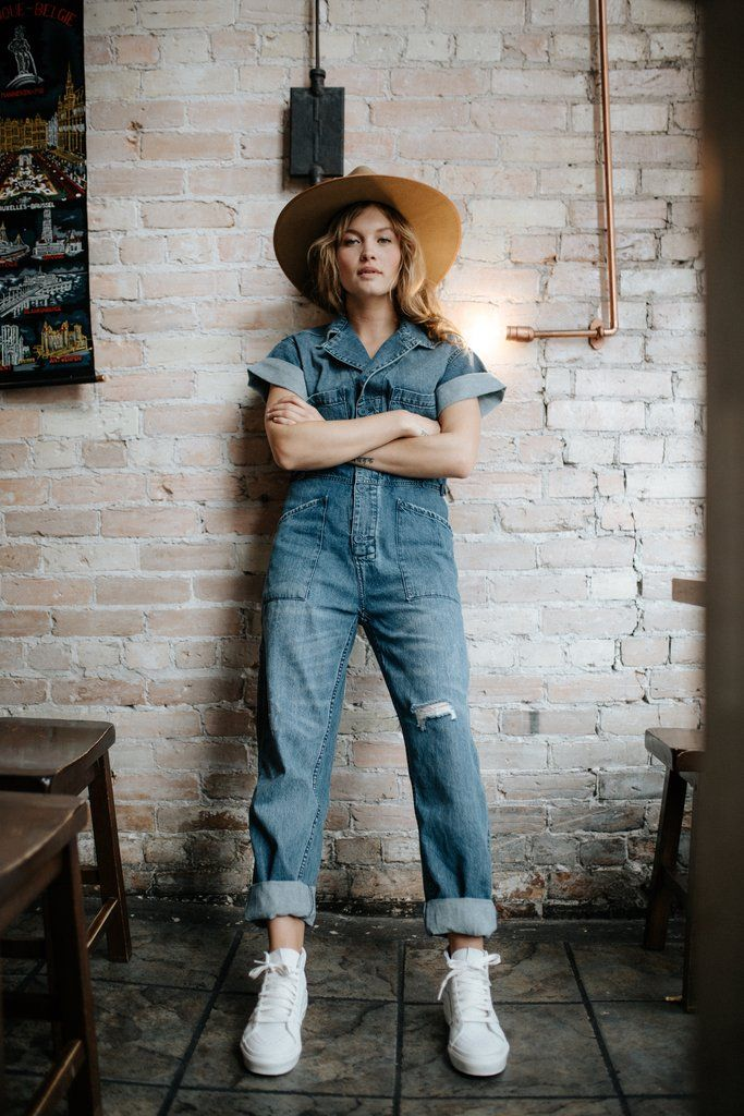 Details: Denim jumpsuit Rolled sleeves Distressed details Botton front Cinched waist Model is 5'4 wearing an extra small Measurements: Measurements are approximate and taken while laying flat across the front. Not doubled. XS: Bust = 49.00cm; Waist = 42.00cm; Length = 134.00cm S: Bust = 54.00cm; Waist = 44.00cm; Length