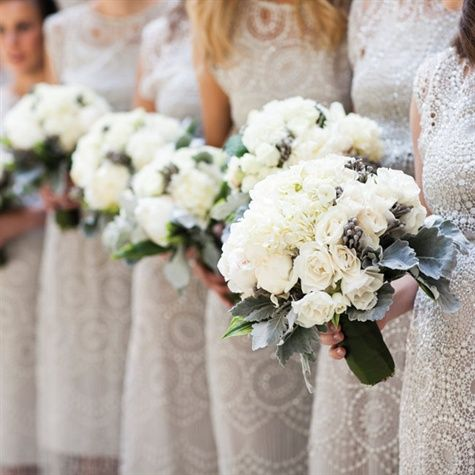 flowers White roses, peonies, dusty miller and berries filled the bridesmaid bouquets