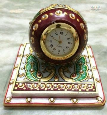 Add a tinge of class to your study table or side table with this handcrafted table clock made of makrana marble. Decorated with golden paint and colourful beads this one is sure to enhance the look of your living space. Made on marble with beautiful embossed work.