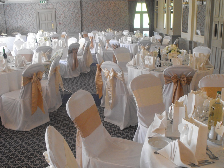 Mixed Gold Satin Bows on White Chair Covers