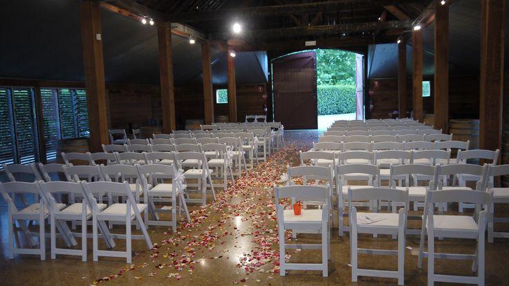 The History Barn at Yerring Station, Yarra Valley in Victoria. A stunning venue with old world charm. Little White Americana Chairs by A&B Weddings - the Settings Specialist, Melbourne Wedding Ceremony Hire.