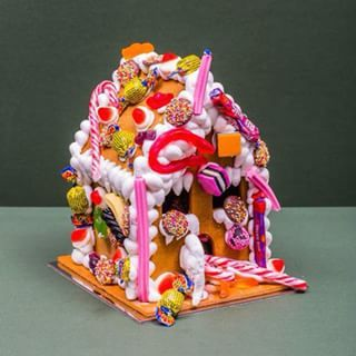 Anna Polyviou's delicious gingerbread house using ALLEN'S lollies such as delicious Strawberries & Cream, FANTALES and FRECKLES.