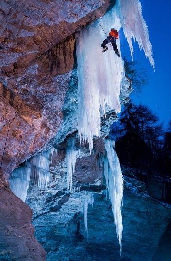 Peter Ortner ice climbing in Zirknitzgrotte, Austria. The daredevil climber braved temperatures of 14F to scale a forest of 40ft ice daggers...