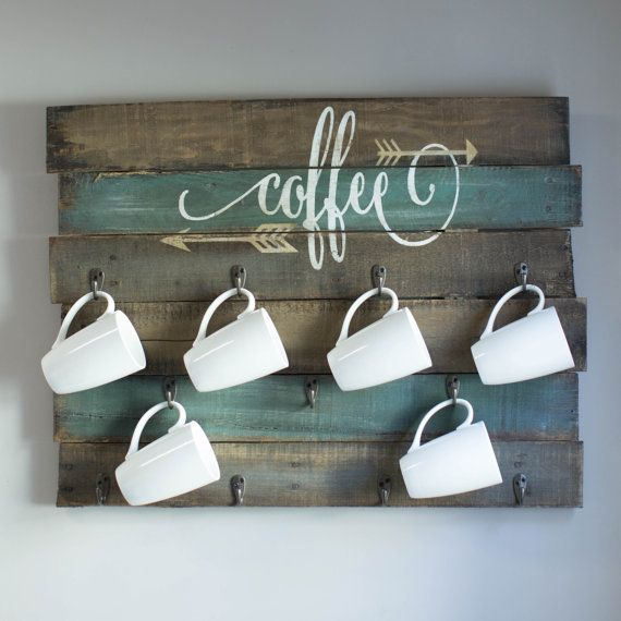 Rustic coffee mug display made from reclaimed pallet wood board. Size: Item measures 30x24 Colors: Background is gray/mocha and jade Antique white