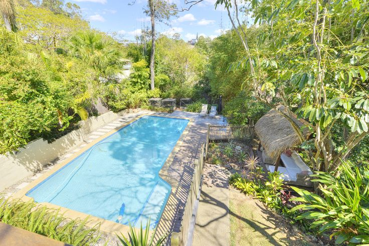 MOUNT GRAVATT EAST...44 Gilliver Street...Set amongst tropical gardens and having at its centrepiece, an oversized sparkling swimming pool.