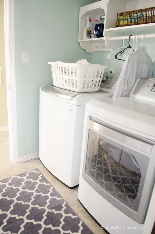 DIY laundry room makeover. LOVE that rug!