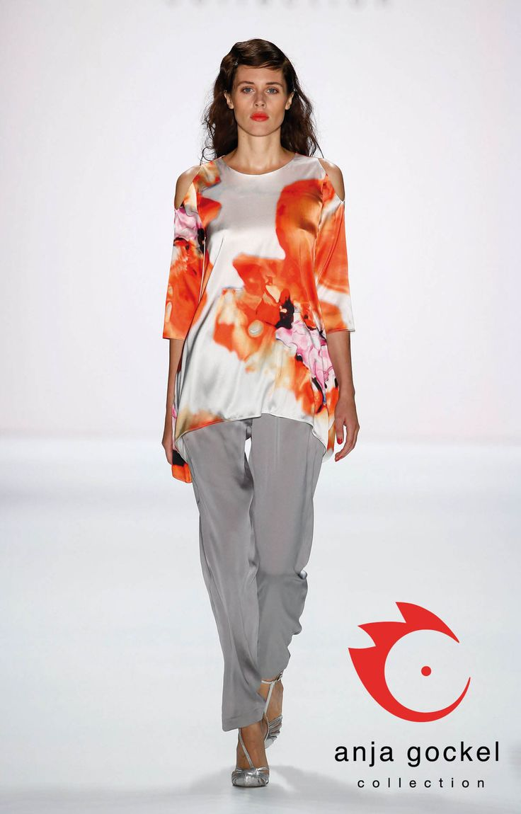 Silken blurred poppy-print longshirt with shoulder cut-outs and straight cut trousers made from grey silk unify to a tender, floating look.