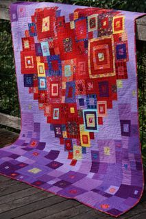 Red and purple heart quilt, hand quilted with perle cotton.