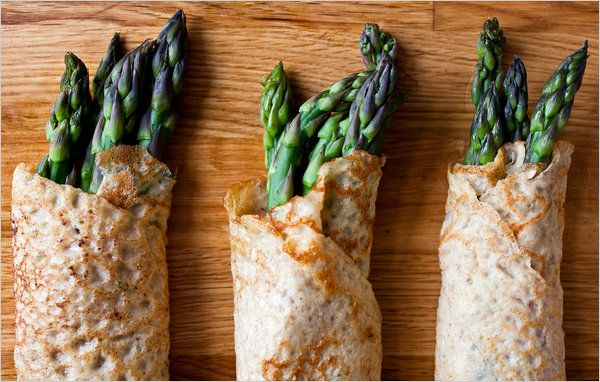 Asparagus rolled in herb crêpes. Photo: Andrew Scrivani for The New York Times