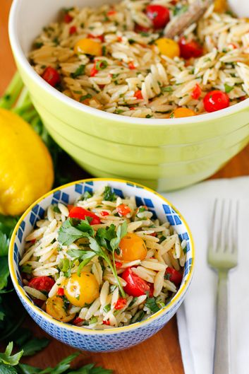 Orzo Salad -- this lemony basil orzo pasta salad is full of bright, fresh, summery flavor... Gorgeous red and yellow cherry tomatoes, bright parsley, and vibrant basil, along with a healthy dose of fresh lemon zest and juice marry together to make the perfect side dish to share at your next gathering!