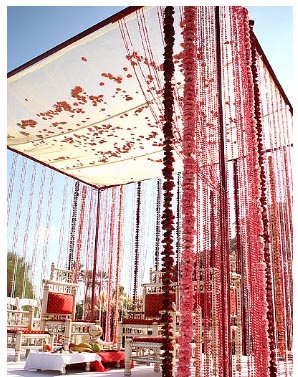 Beautiful silk flowers surround this mandap like it for Artificial flower decoration mandap