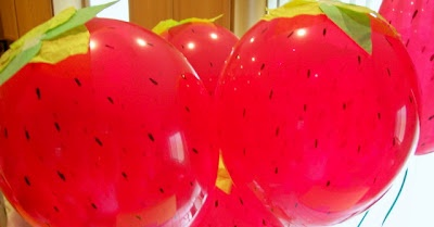 Strawberry balloons .... perfect to hang from green ribbon from the ceiling ...