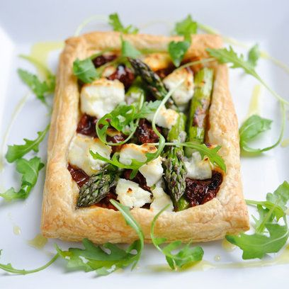 Asparagus tartlets with goats' cheese and sun dried tomatoes. For the full recipe and more dinner party ideas, visit Red Online