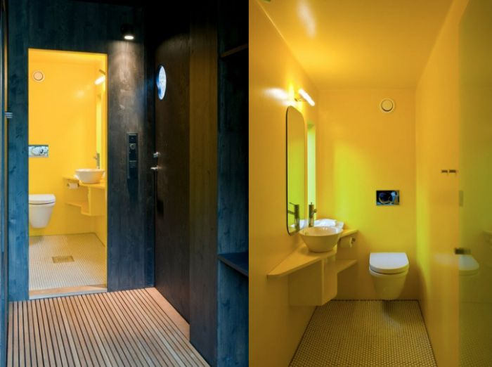 Juvet Landscape Hotel, architect: Jensen & Skodvin. Yellow concrete and wood modern minimalist bathroom in hotel in Norway
