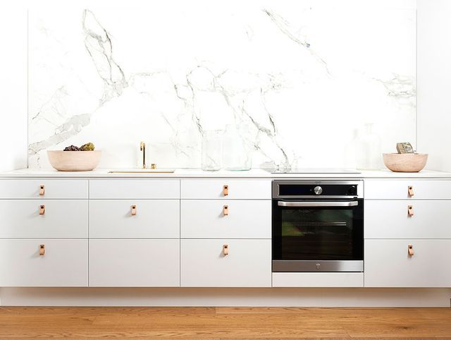 A beautifully stylish look for a kitchen … brass sink and tapwear, white cabinets with leather tab pulls and a Dekton (in aura) countertop and splash-back | by Ballingslov ~ x debra  Dust Jacket on B
