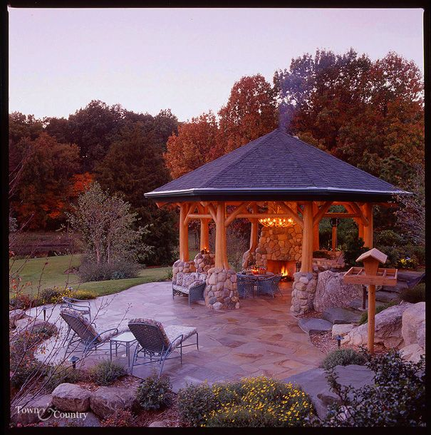 The structural log gazebo contains a masonry fireplace for Outdoor gazebo plans with fireplace