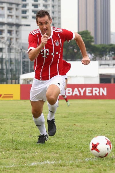 Miroslav Klose of the FC Bayern Muenchen Legends runs with the ball during the FC Bayern International Fanclub Tournament at Singapore Padang Field at the Singapore Cricket Club during the Audi Summer Tour 2017 on July 26, 2017 in Singapore.