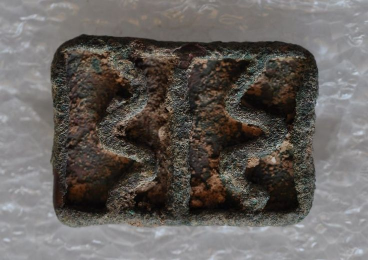 Bactrian bronze compartmented stamp seal with geometric, Afghanistan, Amlash, 2000-1500 B.C. Bactrian bronze compartmented stamp seal with geometric, Afghanistan, Amlash, 3.2 cm long, 1,7 cm high, 13 gr weight. Private collection