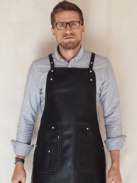 The BLUE & GRAE Black Leather Apron - designed by Blue & Grae and handmade by us in our Brisbane workshop. | Product Details | - full grain black leather - vegetable tanned leather shoulder & waist straps (these straps are adjustable) - solid brass, nickel plated hardware - two pockets