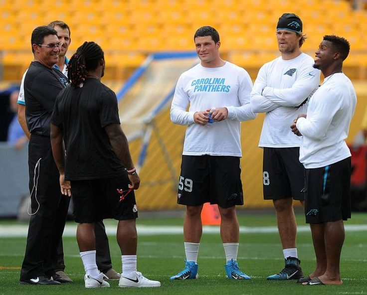 Pittsburgh Steelers running back DeAngelo Williams, back to camera, speaks with Carolina Panthers head coach Ron Rivera, Jordan Gross, linebacker Luke Kuechly, center, tight end Greg Olsen, and running back Jonathan Stewart, right, at Heinz Field prior to the team's preseason game on Thursday, September 3, 2015 in Pittsburgh, PA. Williams formerly played for the Carolina Panthers.