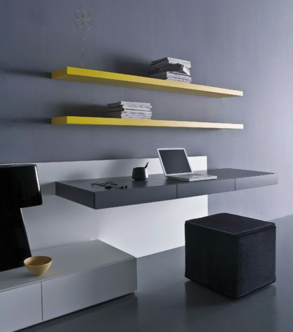bureau suspendu noir et deux étagères jaunes flottantes