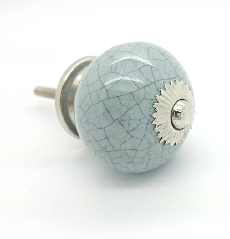 Grey crackle coloured ceramic round cupboard door knob drawer pull handle is suitable for any wardrobe, chest of drawers and cabinet doors.Suitable for decorating chest of drawers, bedroom furniture, set of cupboards, dresser or kitchen furniture and cabinets. These are ideal for room and can decorate your home without many changes. These are made from high quality ceramic with metal fittings.