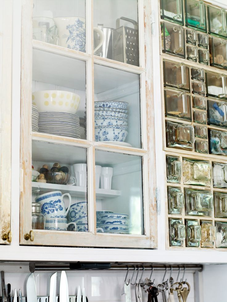 Kitchen cabinets are new and have old windows and doors. Peter. the owner, has also stacked three Swedish spice cabinet modules on each other - Sköna Hem, Sweden