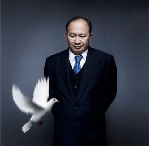 John Woo (Hong Kong action & blockbuster director: 英雄本色 [A Better Tomorrow, 1986], 喋血雙雄 [The Killer, 1989], 辣手神探 [Hard Boiled, 1992], Face/Off [1997], Mission: Impossible II [2000]) Photographer Nicolas Guérin. Doves.