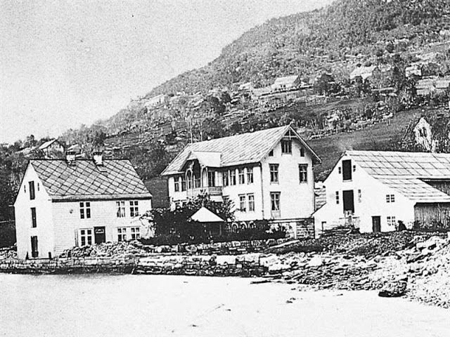 Hotel Ullensvang as seen in 1875 in this historical travel photo showing the original steamship agency to the left and the guest house in the center.