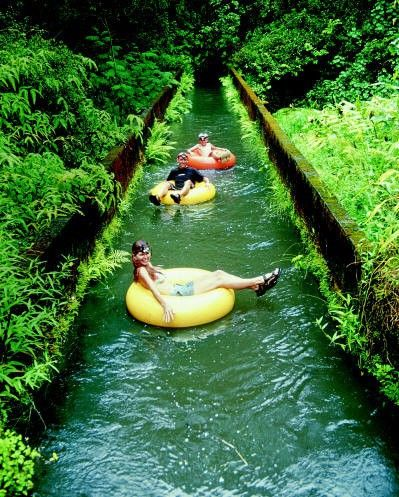 Mountain tubing adventure down the long irrigation ditches of an old sugar plantation