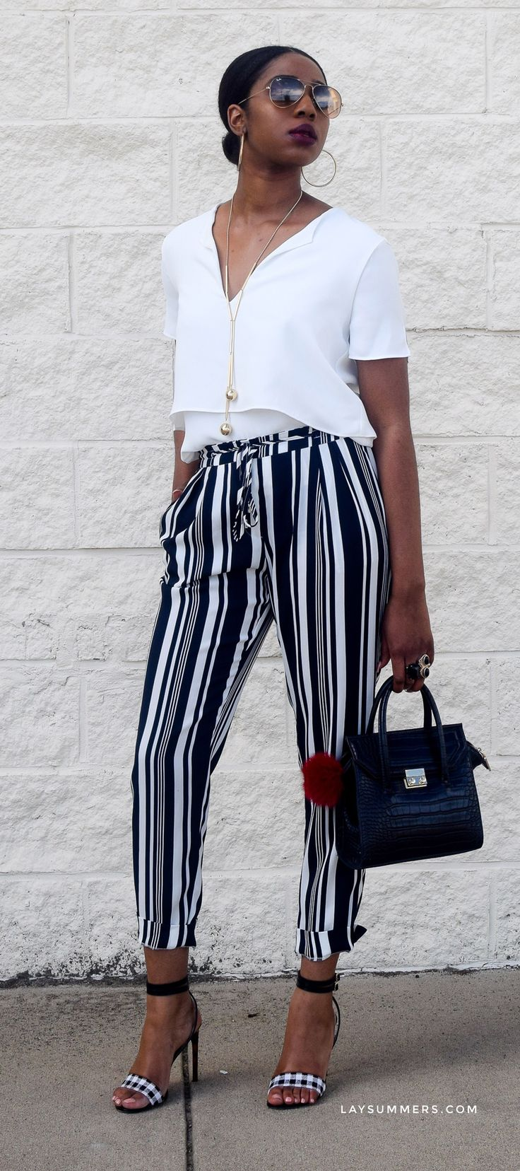 Wearing blue stripes creates a chic summer look that oozes a fresh and calm energy. Learn how you can achieve this same effortlessness in your summer war...