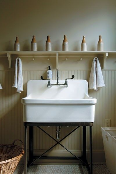 Even a laundry room can be a suitable place for artful displays, such as these antique beer bottles arrayed above a commodious sink in Michelle and John Sonderegger's laundry room.