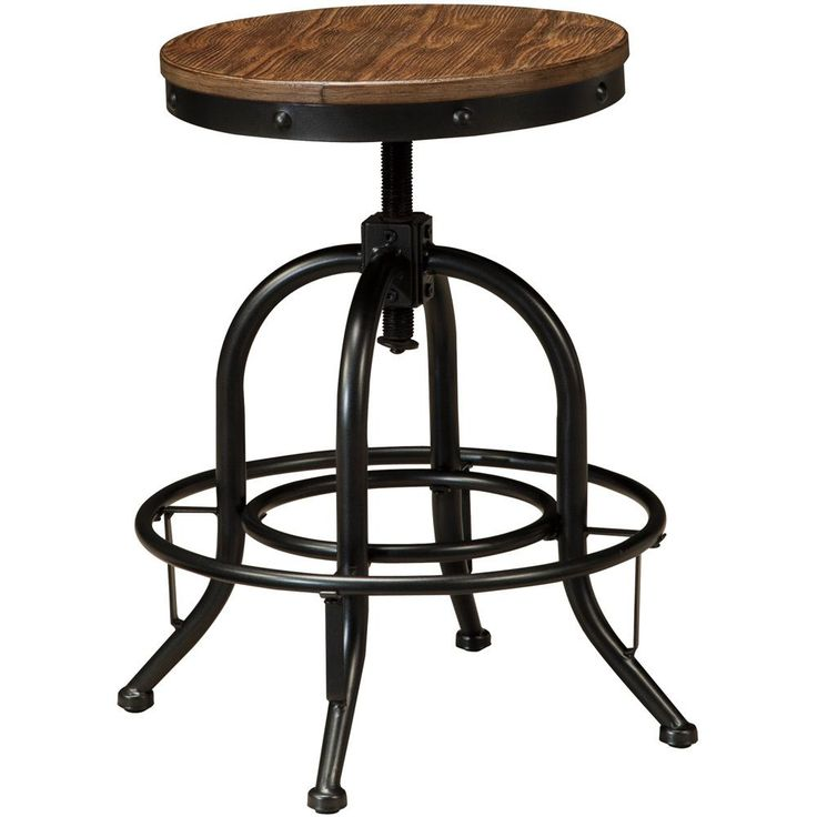 Invite vintage style into your dining room with the Pinnadel stool from Signature Design by Ashley. The bold black metal frame and sleek brown finish will accent your dining decor nicely.