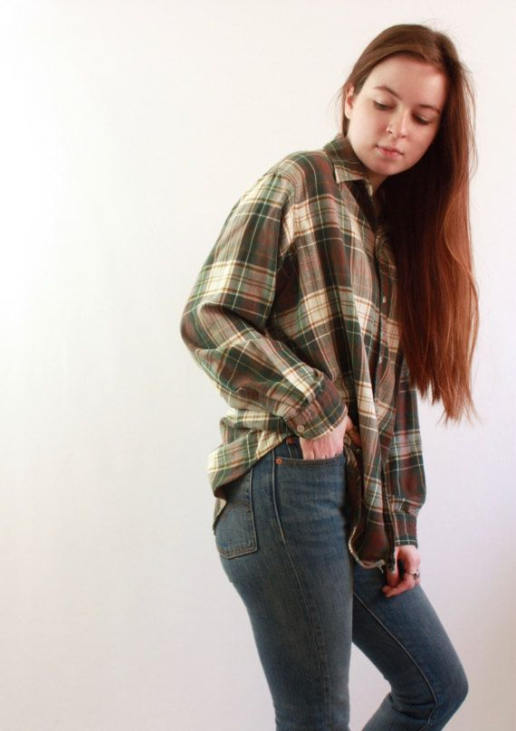 This 90s brown & green flannel shirt by LL Bean is 100% cotton. The size tag is too faded to read, but it fits like a womans medium or a mens small. This shirt is paper thin and very soft. Its in great shape with only general signs of wear. Please use the measurements provided to determine if this piece will fit you as desired. Note that all sales are final, so getting an accurate measurement is especially important. Also, all measurements are taken while garment is laying flat, and shoul...