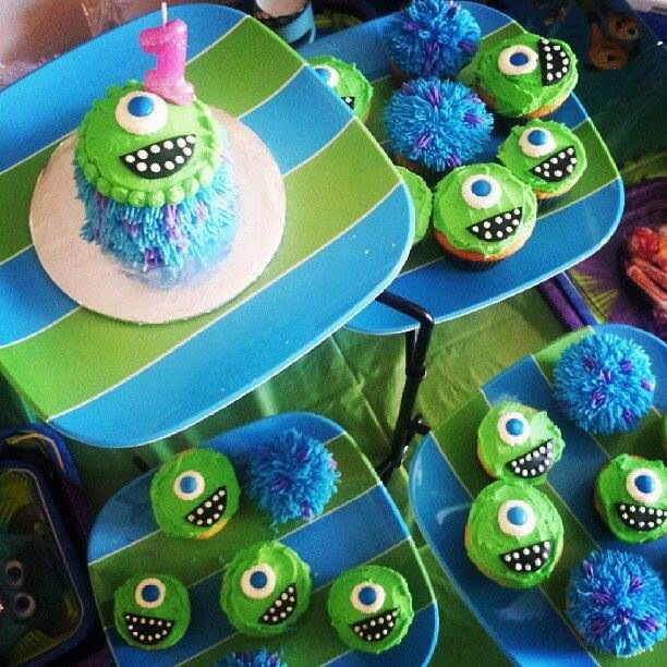 Monsters Inc tin can smash cake with Mike & Sully cupcakes. Buttercream with black fondant mouths & blue M&M eyes.
