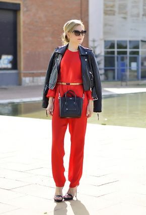 Coral jumpsuit with black jacket and matching heels.