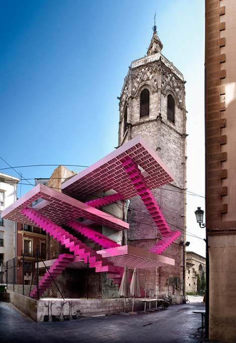 conceptual images by Spanish studio Espai MGR show impossible Lego structures filling vacant neighbourhood plots in Valencia