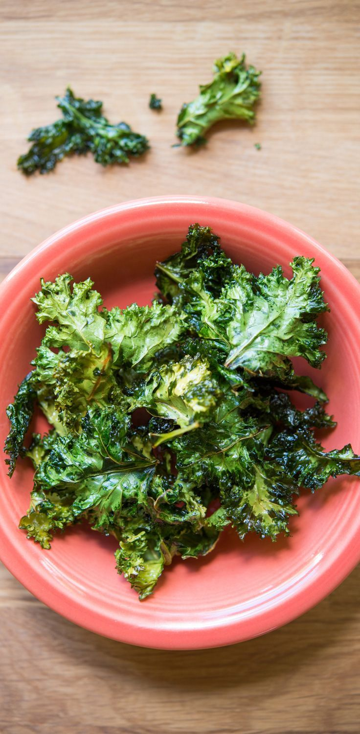 Crunchy, simple, and unbelievably tasty, these kale chips are a perfect way to satisfy a snack attack! // recipes // snacks // healthy recipes // healthy snacks // nutrition // healthy eating // quick snacks // homemade snacks // Beachbody // www.beachbody.com/beachbodyblog