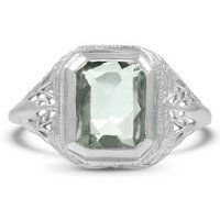 The Porter is a lovely vintage piece created in the Edwardian era. A bountiful garden of floral details make the 18K white gold filigree setting of this ring a spectacular work of art. An emerald-shaped aquamarine, gauged 10x7.9 millimeters, rests at the center, captivating the eye with subtle color. Originally crafted in the 1930's, this ring is sure to bring vintage allure to your personal style (Aquamarine approx. 2.83 total carat weight).