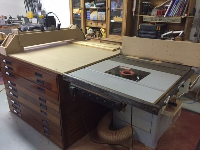 "Complete Woodworking Centre by Brendon - Here is a complete woodworking set-up in less than 4 square metres. It comprises of a saw table with outfeed table, a router table, a reversible fence, a router mill gantry (with a 1/2"" Trend router)  for flattening large boards or slabs and a 9-drawer tool storage cabinet. The fence is reversible by way of  unlocking two mag-switches; it only takes a few seconds to lift the fence off and turn it around. One side is for the saw tab"