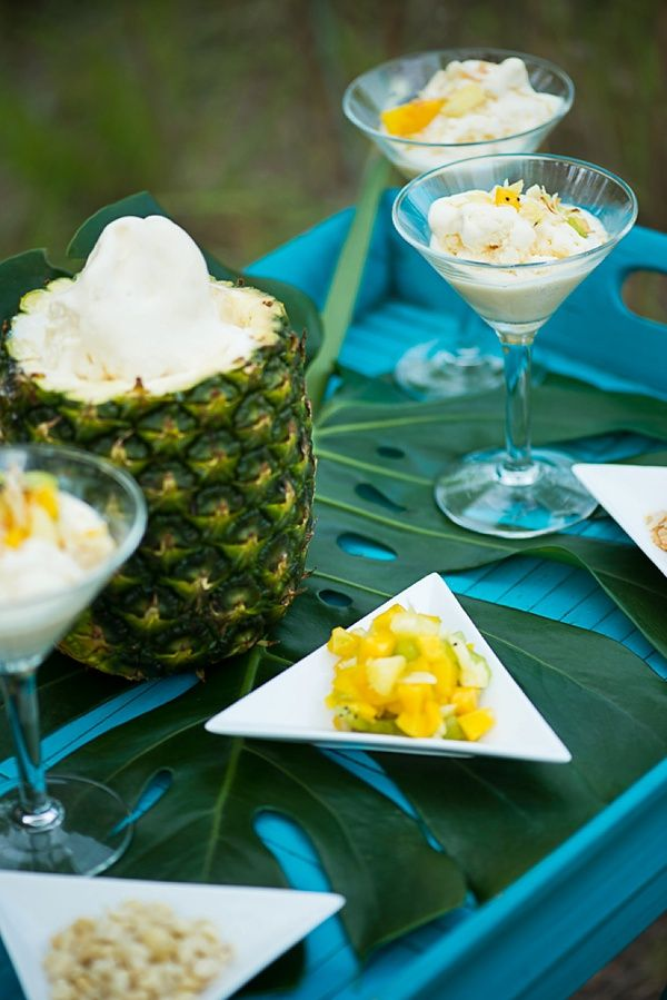 Pineapple ice cream bar with macadamia nuts, mango, kiwi, and coconut for tropical wedding treat