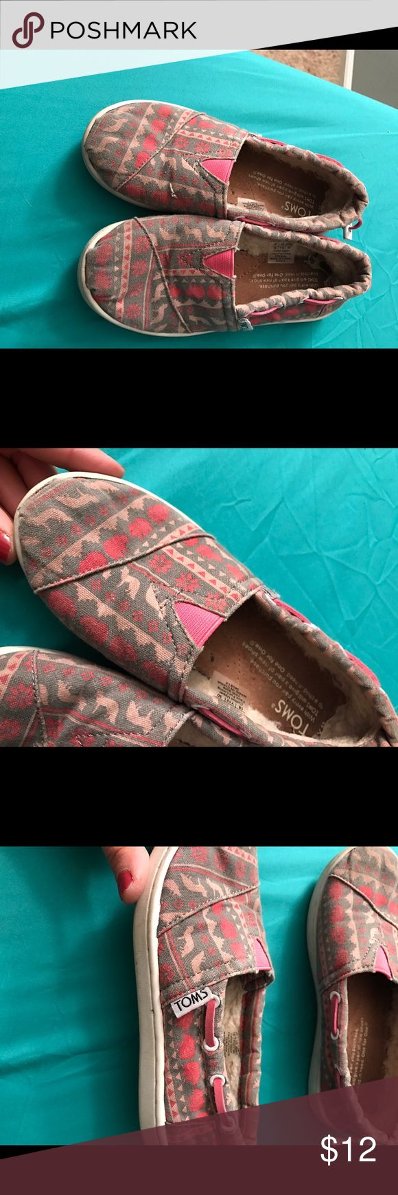 Girls Toms 12 These Toms are so comfy for their feet ! Lined with fur in the back for additional comfort. These are very well loved! A dusty look to them a bit but no stain or rips. Probably need to go through the wash. toms  Shoes Flats & Loafers