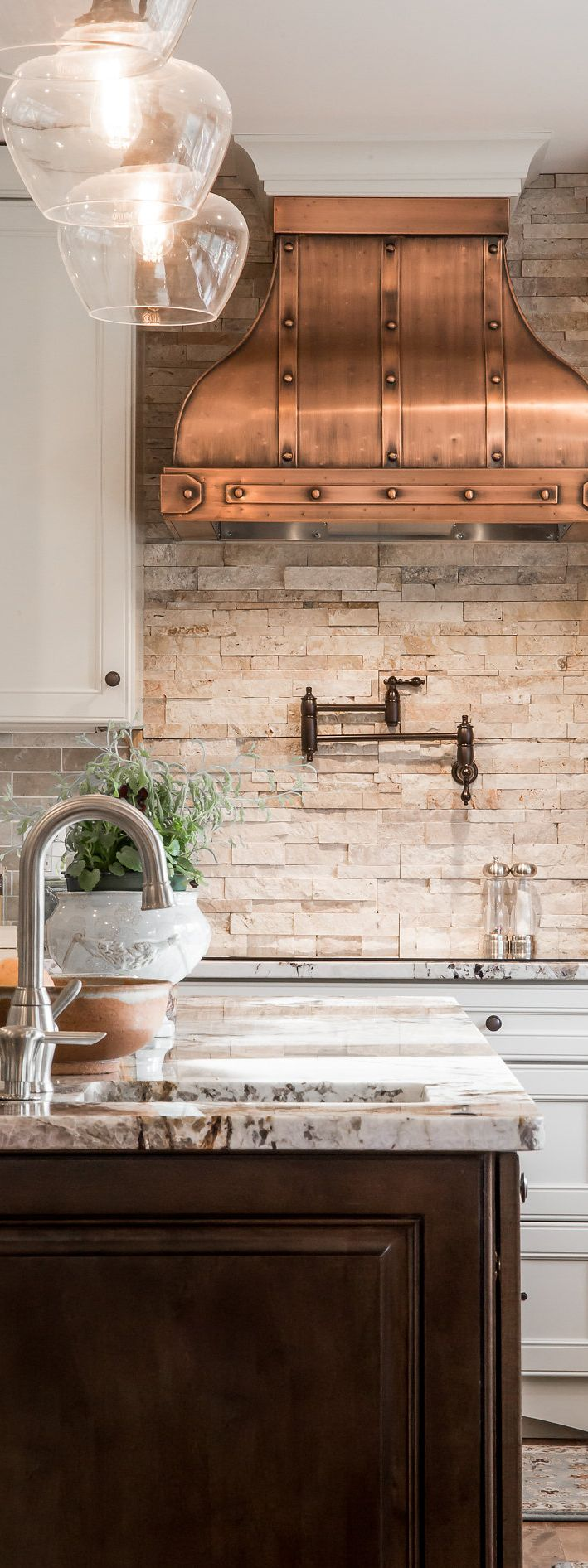 Traditional kitchen with copper accents designed by Kitchen Style.