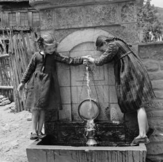 Greece, girls filling pitcher at fountain in Métsovon :: AGSL Digital Photo Archive - Europe