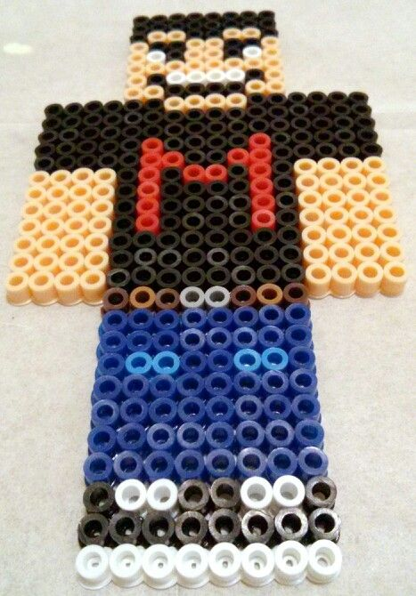 A perler I made of one of my favorite YouTubers, Markiplier! It's his Minecraft skin which you can see in his Drunk Minecraft videos.